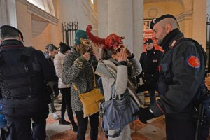 Carabiniere, paramilitary policemen inspects a woman during a Carnival in Venice, Italy, 31 January 2016. ANSA/ANDREA MEROLA
